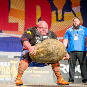 Man Lifting Giant Stone: blank meme template
